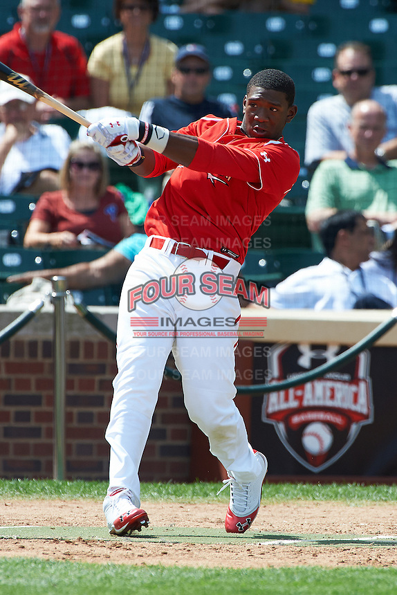 Outfielder Justin Williams #4 of Terrebonne High School in Houma, Louisiana during the home run derby before participating in the Under Armour All-American Game powered by Baseball Factory at Wrigley Field on August 18, 2012 in Chicago, Illinois.  (Mike Janes/Four Seam Images)