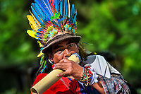 """A native from the Kamentsá tribe, wearing a colorful feather headgear, blows a wind instrument during the Carnival of Forgiveness, a traditional indigenous celebration in Sibundoy, Colombia, 12 February 2013. Clestrinye (""""Carnaval del Perdón"""") is a ritual ceremony kept for centuries in the Valley of Sibundoy in Putumayo (the Amazonian department of Colombia), a home to two closely allied indigenous groups, the Inga and Kamentsá. Although the festival has indigenous origins, the Catholic religion elements have been introduced and merged with the shamanistic tradition. Celebrating annually the collaboration, peace and unity between tribes, they believe that anyone who offended anyone may ask for forgiveness this day and all of them should grant pardons."""