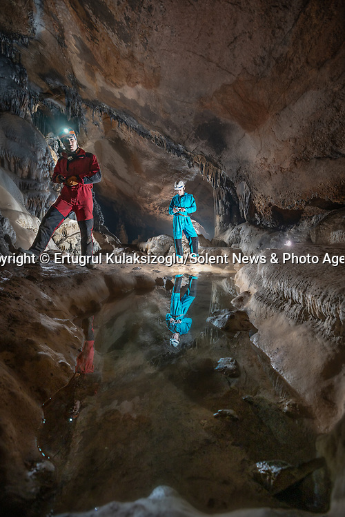 Pictured:   A team of explorers venture through a series of incredible caves filled with huge stalagmites and underwater lakes.<br /> <br /> The adventurers are carrying out tests in the subterranean world to work out how old the caves are and how they were formed.<br /> <br /> The intriguing images were captured in caves across Turkey by amateur photographer Ertuğrul Kulaksizoglu.  SEE OUR COPY FOR FULL DETAILS.<br /> <br /> <br /> Please byline: Ertugrul Kulaksizoglu/Solent News<br /> <br /> © Ertugrul Kulaksizoglu/Solent News & Photo Agency<br /> UK +44 (0) 2380 458800