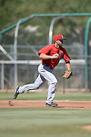 Los Angels Angels of Anaheim third baseman Cal Towey (25) chases a runner back to second during an instructional league game against the Colorado Rockies on September 30, 2013 at Tempe Diablo Stadium Complex in Tempe, Arizona.  (Mike Janes/Four Seam Images)