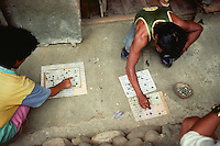Ifugao men playing bingo on a Sunday afternoon. Ifugaos are one of the ethno-linguistic groups residing in the Philippine Cordillera at the northeastern part of main island of Luzon, Philippines.  Kiangan, Ifugao. September, 1998
