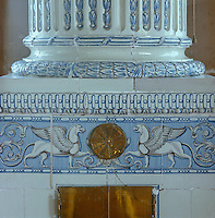 Detail of a late Gustavian blue and white tiled stove (c. 1795) shaped like a column on a square plinth