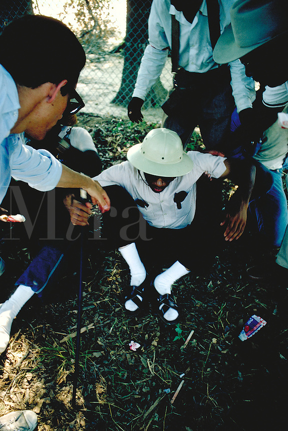 James Meredith March Through Mississippi, June 1966. Rest stop along route - James Meredith, wounded in shooting incident on first day of march, is helped to his feet. Civil Rights. James Meredith.