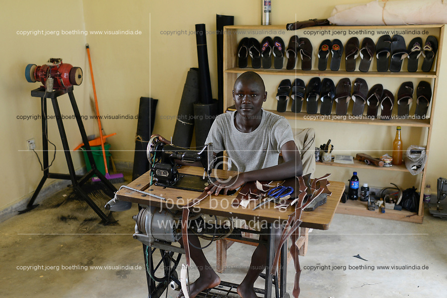 UGANDA, Kampala, Kampiringisa, national rehabilitation center, a juvenile-detention facility for children and young people, vocational training, shoemaker workshop  / Jugendhaftanstalt und Rehabilitationszentrum Kampiringisa, Berufsausbildung in Schuster Werkstatt, Schueler Charles Baguma, 16 Jahre