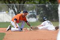 Gettysburg Bullets infielder Scott Zanghellini (24) puts the tag down as Zack Creekmore (10) steals second during the second game of a doubleheader against the Edgewood Eagles at the Lee County Player Development Complex on March 10, 2014 in Fort Myers, Florida.  Edgewood defeated Gettysburg 5-1.  (Mike Janes/Four Seam Images)