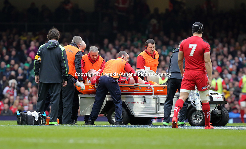 Pictured: Lee Samson of Wales is taken away by paramedics after getting injured Saturday 14 March 2015<br /> Re: RBS Six Nations, Wales v Ireland at the Millennium Stadium, Cardiff, south Wales, UK.