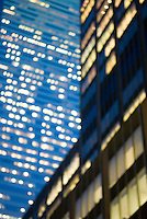 Soft Focus/Defocused view of Office Buildings in Midtown Manhattan, windows illuminated at night....New York City, New York State, USA