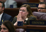Nevada Assemblywoman Maggie Carlton, D-Las Vegas, listens as Gov. Brian Sandoval delivers his State of the State address at the Legislative Building in Carson City, Nev., on Thursday night, Jan. 15, 2015. (Las Vegas Review-Journal/Cathleen Allison)