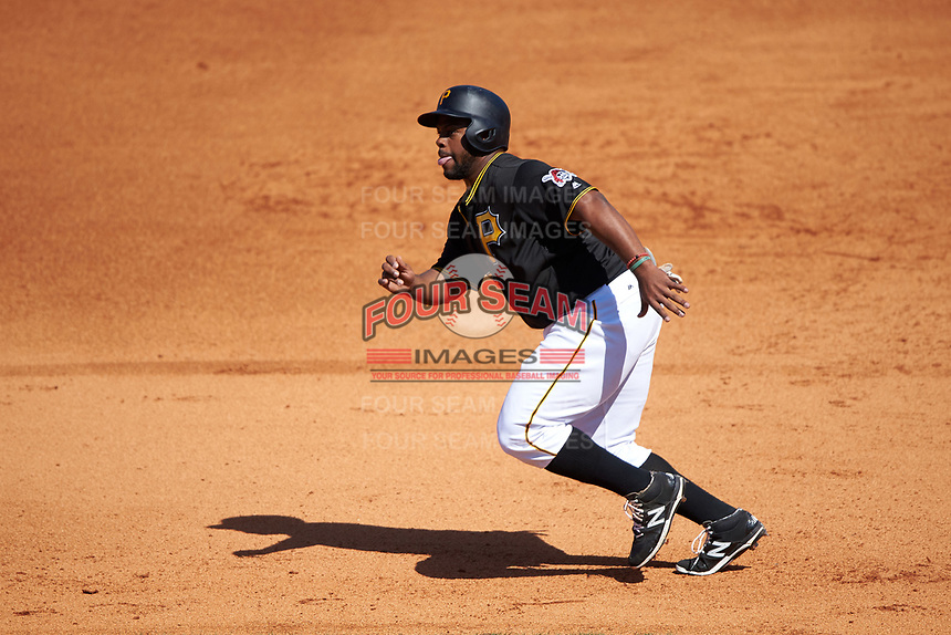 Pittsburgh Pirates pinch hitter Jason Rogers (15) leads off first base during a Spring Training game against the Boston Red Sox on March 9, 2016 at McKechnie Field in Bradenton, Florida.  Boston defeated Pittsburgh 6-2.  (Mike Janes/Four Seam Images)