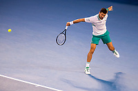 18th February 2021, Melbourne, Victoria, Australia; Novak Djokovic of Serbia returns the ball during the semifinals of the 2021 Australian Open on February 18 2021, at Melbourne Park in Melbourne, Australia.