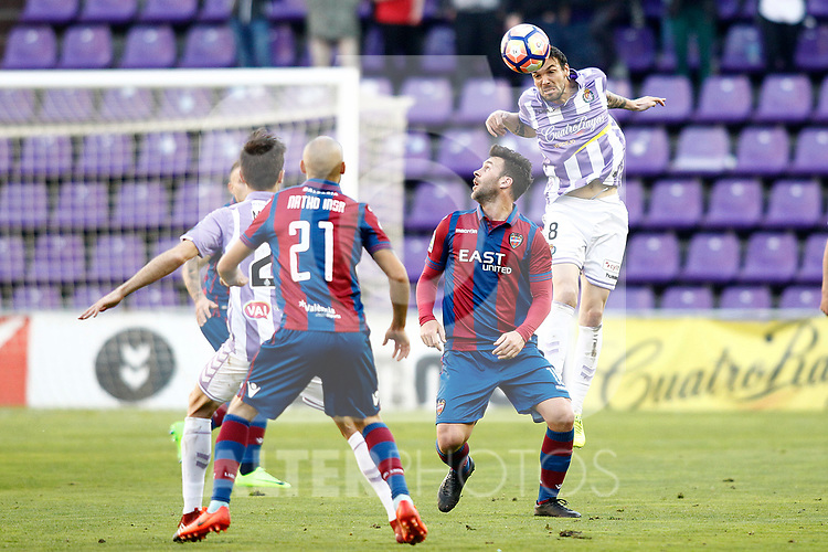 Real Valladolid's Andre Leao (r) and Levante UD's Natxo Insa (l) and Victor Casadesus during La Liga Second Division match. March 11,2017. (ALTERPHOTOS/Acero)