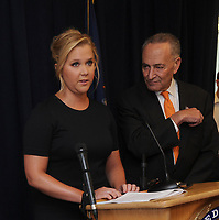 NEW YORK, NY - AUGUST 03: Democratic Senator Chuck Schumer and comedian Amy Schumer hold a joint press conference announcing plans to crackdown on mass shootings and gun violence on August 3, 2015 in New York City. This comes in the wake of the recent shooting in Louisiana.<br /> <br /> People:  Senator Chuck Schumer, Amy Schumer
