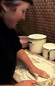 Nr Poti, Georgia. Woman making bread.