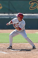 Casey Rodrigue #9 of the Indiana Hoosiers bunts against the Long Beach State Dirtbags at Blair Field on March 15, 2014 in Long Beach, California. Indiana defeated Long Beach State 2-1. (Larry Goren/Four Seam Images)