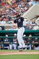 Detroit Tigers right fielder Nicholas Castellanos (9) hits a double during a Grapefruit League Spring Training game against the New York Yankees on February 27, 2019 at Publix Field at Joker Marchant Stadium in Lakeland, Florida.  Yankees defeated the Tigers 10-4 as the game was called after the sixth inning due to rain.  (Mike Janes/Four Seam Images)
