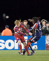 FC Dallas midfielder Dax McCarty (13) and New England Revolution midfielder Shalrie Joseph (21) battle for a ball. The New England Revolution defeated FC Dallas, 2-1, at Gillette Stadium on April 4, 2009. Photo by Andrew Katsampes /isiphotos.com