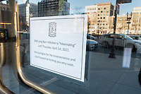"""A sign on the door of OAK Long Bar + Kitchen says that the restaurant, connected to the Copley Plaza Hotel, is """"hibernating"""" until April 1st, 2021, one of many restaurants temporarily closing during the ongoing Coronavirus (COVID-19) global pandemic, seen here in Boston, Massachusetts, on Sun., Jan. 10, 2021."""