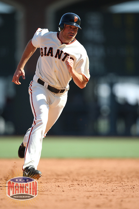 SAN FRANCISCO - SEPTEMBER 7:  Nate Schierholtz of the San Francisco Giants runs the bases during the game against the Pittsburgh Pirates at AT&T Park in San Francisco, California on September 7, 2008.  The Giants defeated the Pirates 11-6.  Photo by Brad Mangin