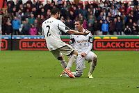 Sunday, 26 April 2014<br /> Pictured: Pablo Hernandez of Swansea (R) celebrating his goal with Jordi Amat (L) making the score 3-1 to his team. <br /> Re: Barclay's Premier League, Swansea City FC v Aston Villa at the Liberty Stadium, south Wales.