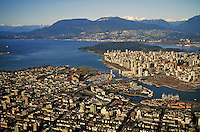 aerial view of city looking north with False Creek and Granville Island in the foreground.