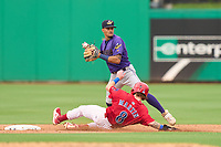 Fort Myers Mighty Mussels shortstop Will Holland (4) throws to first base as Casey Martin (8) slides in during a game against the Clearwater Threshers on July 29, 2021 at BayCare Ballpark in Clearwater, Florida.  (Mike Janes/Four Seam Images)