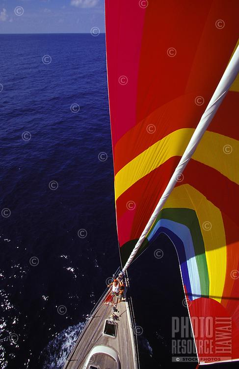 Ocean cruising yacht Heron sailing under spinnaker in blue waters off Oahu, Hawaii