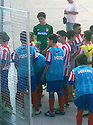 """Collect pic of Josuha Rae, who is 6' 1"""" despite only being 12 years old (green top), before he plays one of his games during his trial with Atletico de Madrid.."""