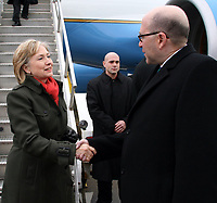 U.S. Secretary of State Hillary Rodham Clinton is welcomed by U.S. Ambassador to Canada David Jacobson upon arrival in Montreal, Canada January 25, 2010. [U.S. Embassy Ottawa Photo / Public Domain]