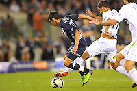 MELBOURNE, AUSTRALIA - FEBRUARY 5, 2010: Aziz Behich from Melbourne Victory competes for the ball in round 26 of the A-league match between Melbourne Victory and North Queensland Fury at Etihad Stadium on February 5, 2010 in Melbourne, Australia. Photo Sydney Low www.syd-low.com