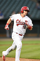Peoria Chiefs catcher Carson Kelly (19) runs to first during a game against the Kane County Cougars on June 2, 2014 at Dozer Park in Peoria, Illinois.  Peoria defeated Kane County 5-3.  (Mike Janes/Four Seam Images)