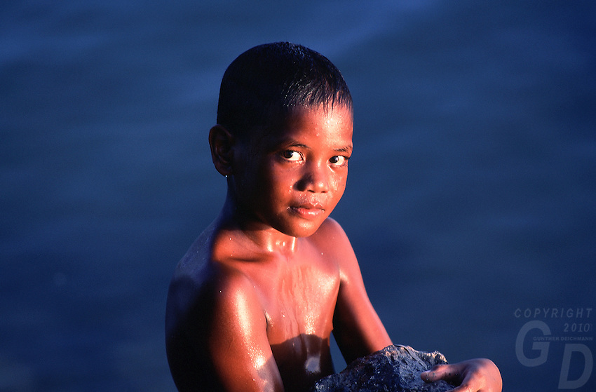 A young Palauan Boy in the afternoon sun after a swim, Palau, Micronesia