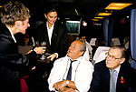 John Gold Johnny Gold, British restaurateur and club owner, Tramps is his most famous club in London.  (wearing white shirt) & TV broadcaster Alan Wicker, being served with champagne on a bus coach trip to a new club in Birmingham he was opening. 1990s UK