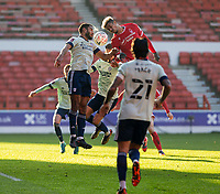 9th January 2021; City Ground, Nottinghamshire, Midlands, England; English FA Cup Football, Nottingham Forest versus Cardiff City; Lyle Taylor of Nottingham Forest and Curtis Nelson of Cardiff City challenge for a header