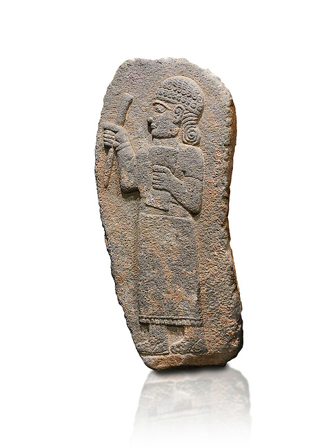 Hittite monumental relief sculpture of a figure holding a document. Adana Archaeology Museum, Turkey. Against a white background