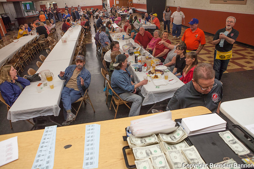 Tthe organizers table with cash and a list of prizes  for a meat raffle at the  Moose Lodge in Lancaster, NY. Meat raffles have become poular fundraisers in Western New York. April 17, 2016