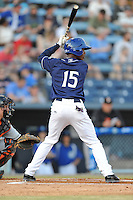 Asheville Tourists left fielder Raimel Tapia #15 awaits a pitch during opening night game against the Delmarva Shorebirds at McCormick Field on April 3, 2014 in Asheville, North Carolina. The Tourists defeated the Shorebirds 8-3. (Tony Farlow/Four Seam Images)