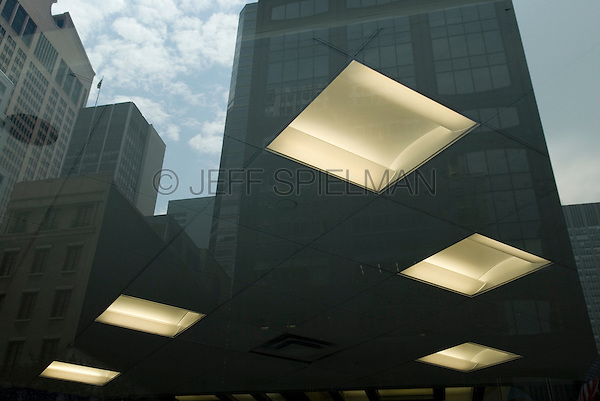 AVAILABLE FROM PLAINPICTURE FOR COMMERCIAL AND EDITORIAL LICENSING.  Please go to www.plainpicture.com and search for image # p5690209.<br /> <br /> City Window Reflection - Office Ceiling Lights and Office Buildings Refected in a Window on 57th Street, Midtown Manhattan, New York City, New York State, USA