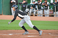 Omar Carrizales (8) of the Grand Junction Rockies at bat against the Ogden Raptors during Opening Night of the Pioneer League Season on June 16, 2014 at Lindquist Field in Ogden, Utah. (Stephen Smith/Four Seam Images)