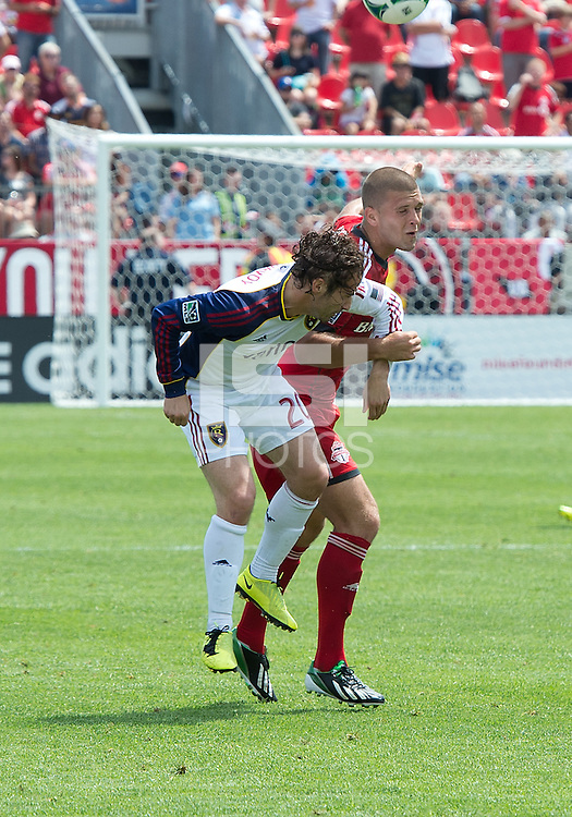 29 June 2013: Real Salt Lake midfielder Ned Grabavoy #20 and Toronto FC midfielder Ryan Richter #33 in action during an MLS game between Real Salt Lake and Toronto FC at BMO Field in Toronto, Ontario Canada.<br /> Real Salt Lake won 1-0.
