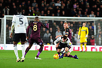 Mason Mount of Derby County is tackled by Mike van der Hoorn of Swansea City during the Sky Bet Championship match between Derby City and Swansea City at the Pride Park Stadium in Derby, England, UK. Saturday 01 December 2018