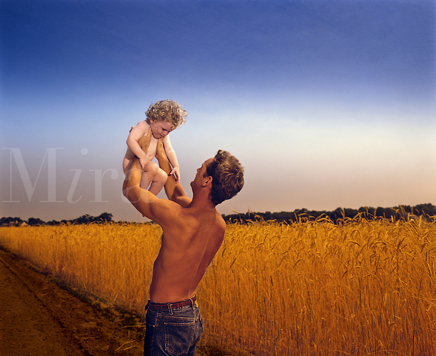 Father with daughter in rural setting<br />