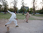 Salwar kameez clad cricketers  in downtown Islamabad. The capital of Pakistan has been in turmoil  recently as the Government faces political upheaval and the ever present threat of the Taliban.
