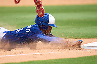 Toronto Blue Jays Angel Del Rosario (43) slides head first into third base during an Extended Spring Training game against the Philadelphia Phillies on June 12, 2021 at the Carpenter Complex in Clearwater, Florida. (Mike Janes/Four Seam Images)