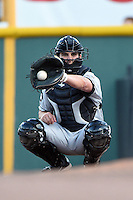Omaha Storm Chasers catcher Beau Maggi (45) warms up the pitcher in the bullpen during the first game of a double header against the Nashville Sounds on May 21, 2014 at Herschel Greer Stadium in Nashville, Tennessee.  Nashville defeated Omaha 5-4.  (Mike Janes/Four Seam Images)