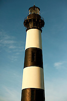 The striking black-and-white-striped Bodie Island Lighthouse located on Bodie Island on North Carolina's Outer Banks. The light house, built in 1872, stands 156 feet tall and is located on the Roanoke Sound side of the first island that is part of the Cape Hatteras National Seashore. The lighthouse is just south of Nag's Head, a few miles before Oregon Inlet. The conical-shaped lighthouse has white and black bands with a black lantern house. Charlotte NC photographer Patrick Schneider has extensive photo collections of the following lighthouses: Bodie Island Lighthouse, Bald Head Island Lighthouse, Cape Fear Lighthouse, Cape Hatteras Lighthouse, Cape Lookout Lighthouse, Currituck Beach Lighthouse, Diamond Shoal Lighthouse, Federal Point Lighthouse, Oak Island Lighthouse, and Ocracoke Lighthouse on Ocracoke Island.