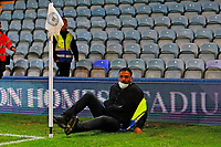 28th August 2021; Weston Homes Stadium, Peterborough, Cambridgeshire, England; EFL Championship football, Peterborough United versus West Bromwich Albion; A steward lies on the floor after being pushed over by a West Bromwich Albion player