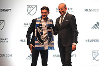 Philadelphia, PA - Thursday January 19, 2018: Paul Marie, Don Garber during the 2018 MLS SuperDraft at the Pennsylvania Convention Center.