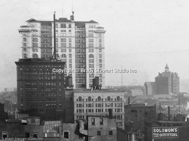 Pittsburgh PA:  View of the Frick building and Duquesne College from the roof of the Empire Building.  The building was completed in 1902 and is still in operation today. The building overshadows the smaller Carnegie Building (in front of the Frick Building).