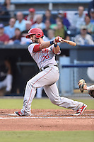Hagerstown Suns first baseman Carlos Lopez #26 swings at a pitch during a game against the Asheville Tourists at McCormick Field September 8, 2014 in Asheville, North Carolina. The Tourists defeated the Suns 16-7. (Tony Farlow/Four Seam Images)