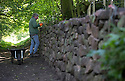 "24/05/16 <br /> <br /> Steve Clifton works on restoring the wall.<br /> <br /> A mammouth restoration project, that could take up to twenty years to complete, is underway on the forgotten ancient stone walls that were once part of an intriguing track way, which pre-dates the railways.<br /> <br /> FULL STORY HERE:  http://www.fstoppress.com/articles/forgotten-stone-walls-set-for-restoration/<br /> <br /> .Imagine a giant 3D jigsaw puzzle with no instructions, and you have an idea of the challenge facing  these traditional dry-stone wallers, who are hard at work restoring the Cauldon Plateway, a relic of Staffordshire's industrial history.<br /> <br /> It's back-breaking work, as each stone has to be returned as close as possible to its original position according to weight and size, with bigger, heavier stones towards the bottom and a rounded ""coping"" stone at the very top.<br /> <br /> All Rights Reserved: F Stop Press Ltd. +44(0)1335 418365   +44 (0)7765 242650 www.fstoppress.com"
